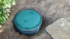 Placing Septic Cover On Riser